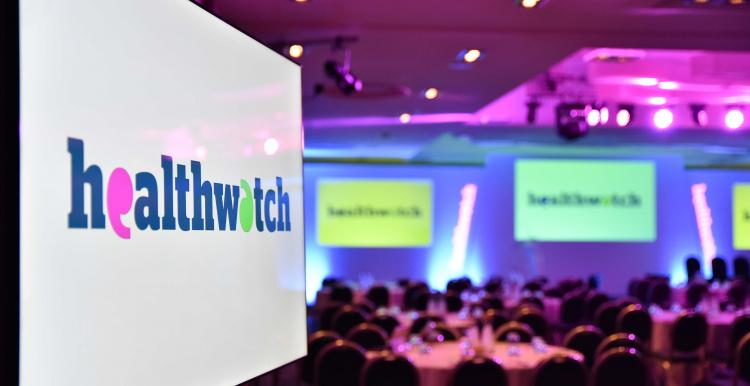 A screen at the Healthwatch awards ceremony in 2019 with the Healthwatch logo displayed
