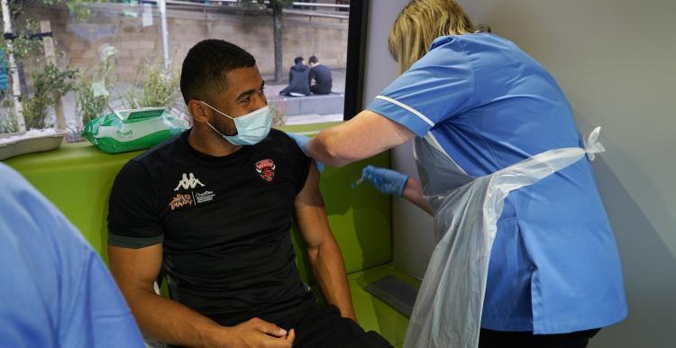 Kallum Watkins getting his vaccine