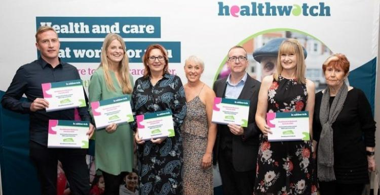 Healthwatch staff from across Greater Manchester holding their award certificates
