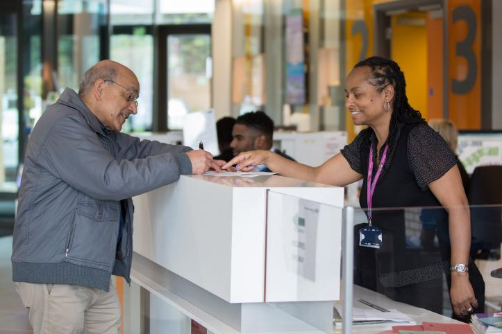 Patient speaking to a receptionist