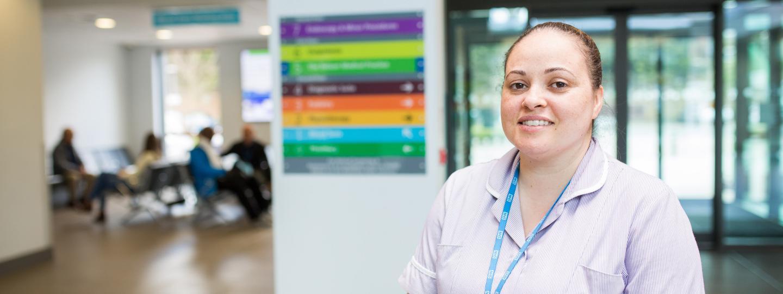 Nurse stood in a Hospital reception